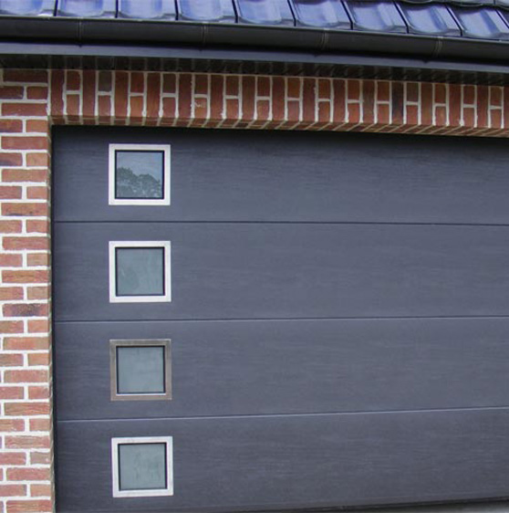 Portes de garage floret fr res maisons en ossature bois for Porte de garage sda